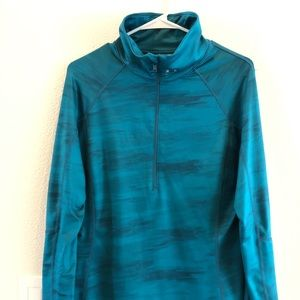 Turquoise Under Armour shirt. Layer or wear alone